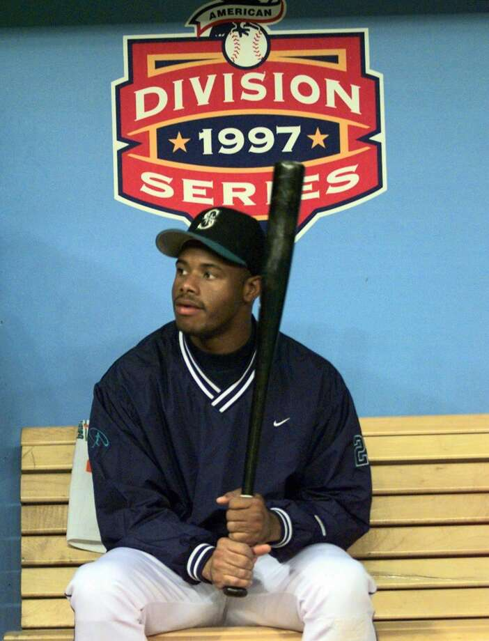 Griffey takes a break in the dugout before the opening game of the A.L. Division Series against the Orioles on Oct. 1, 1997, in Seattle. The M's lost the ALDS 3-1 games.