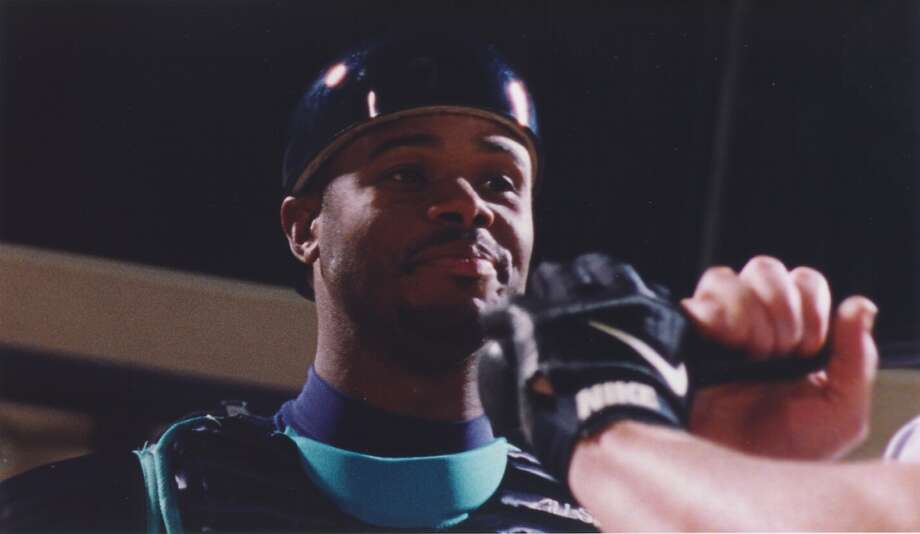 In this photo from March 11, 1998, Griffey wears catcher's gear in a Mariners commercial in which Junior is every player on the team.