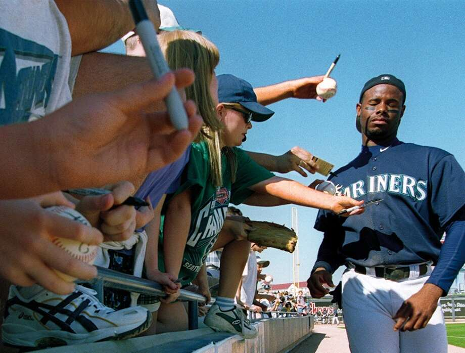 The caption on this March 31, 1998, Seattle Post-Intelligencer photo reads: ''Ken Griffey is the most sought-after signature at spring training and maybe in all of baseball.  He rarely and signs and does not enjoy it.''