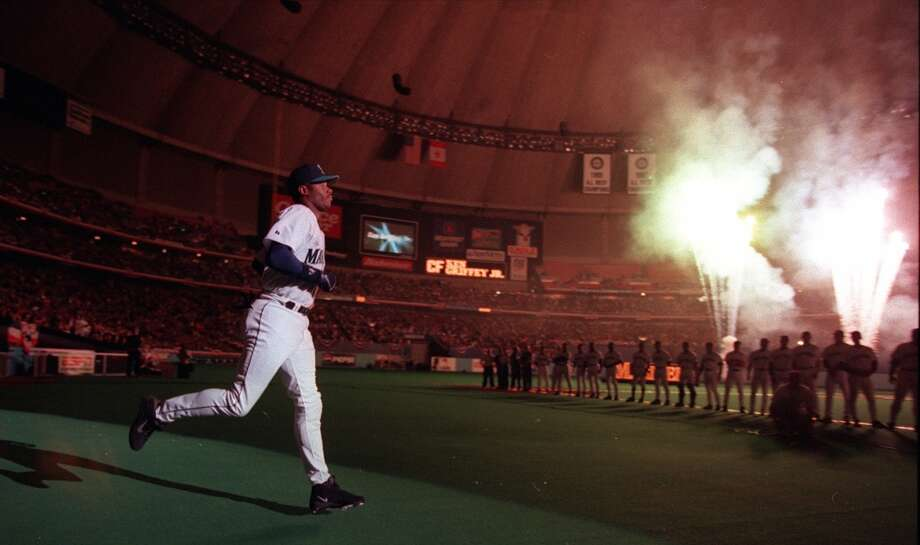 Griffey runs out to the field as his name is called during opening ceremonies for the 1999 season at the Kingdome on April 5, 1999.