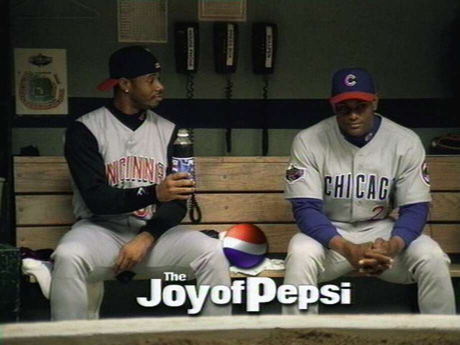 In 2001, Griffey was doing his thing in Cincinnati while the Mariners won 116 games that season. But Junior was still a huge star, appearing in advertisements like this one for Pepsi. Sitting next to him is Cubs star Sammy Sosa.