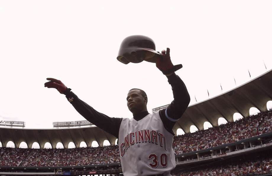 Griffey hit his 500th career home run on June 20, 2004, as a member of the Cincinnati Reds. Here, he acknowledges the crowd at Busch Stadium in St. Louis after reaching the milestone.