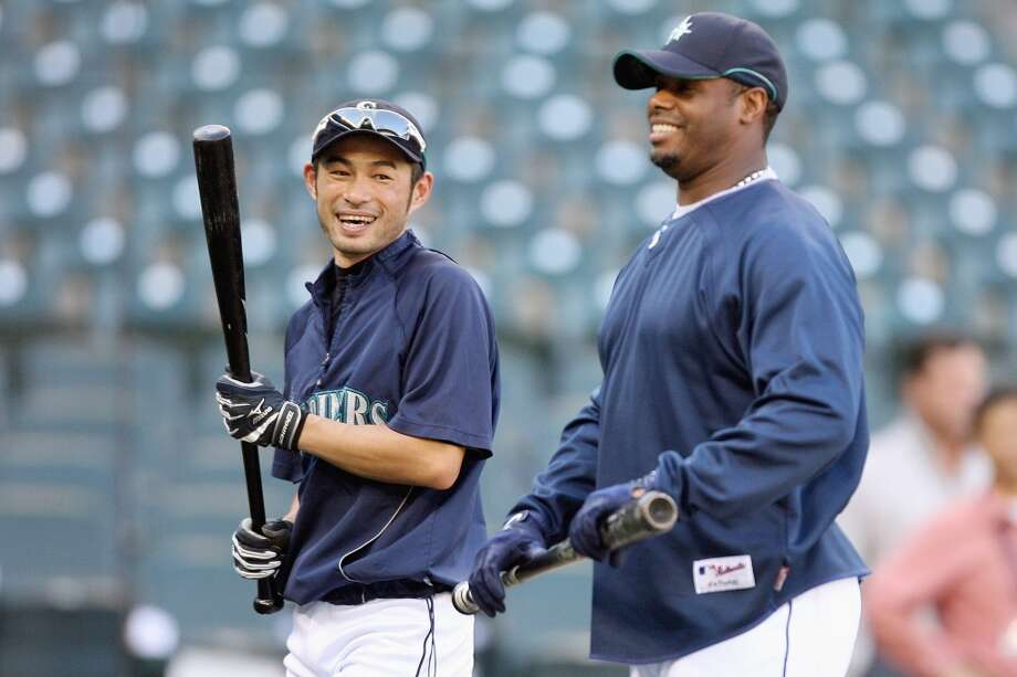 Griffey chats with Ichiro Suzuki during batting practice before a game against the Yankees on Sept. 18, 2009, at Safeco Field.