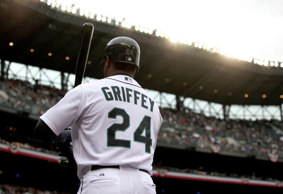 Ken Griffey Jr. warms up on deck during the home opener April 12, 2010, in Seattle.