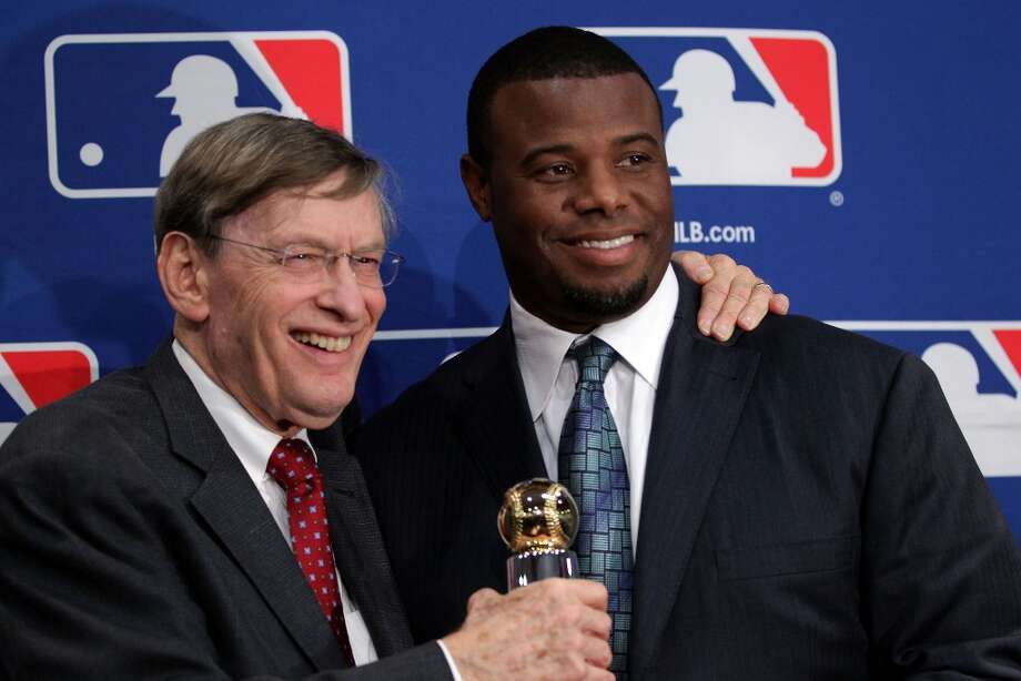 MLB commissioner Bud Selig presents the Commissioner's Historic Achievement Award to Ken Griffey Jr. prior to Game 4 of the World Series between the Cardinals and Rangers at the Ballpark in Arlington, Texas, on Oct. 23, 2011.