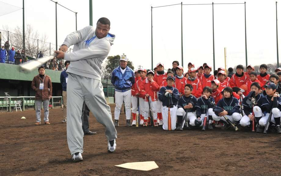 Before the 2012 season, Griffey signed on to be a special consultant for the Mariners. Here he holds a baseball clinic for Japanese boys at Yomiuri Giants Stadium outside Tokyo on Jan. 15, 2012.