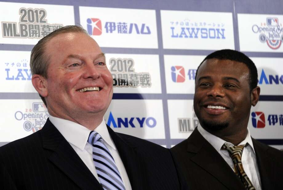 Former Mariners manager Eric Wedge laughs with Griffey during a news conference in Tokyo on Jan. 16, 2012, when the team announced playing an opening series against the Oakland A's in Japan that March.