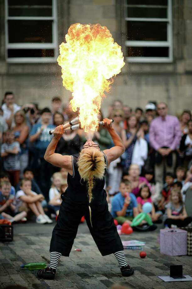 A street entertainer performs on Edinburgh's Royal Mile during the city's Festival Fringe on August 7, 2013 in Edinburgh, Scotland. Photo: Jeff J Mitchell, Getty Images / 2013 Getty Images
