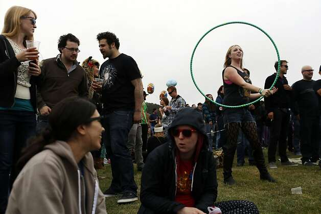 Kaelyn Smith hula hoops while waiting for The National to play at the Lands End stage during the first day of the Outside Lands music festival in Golden Gate Park in San Francisco, Calif. on August 9, 2013. Photo: Ian C. Bates, The Chronicle