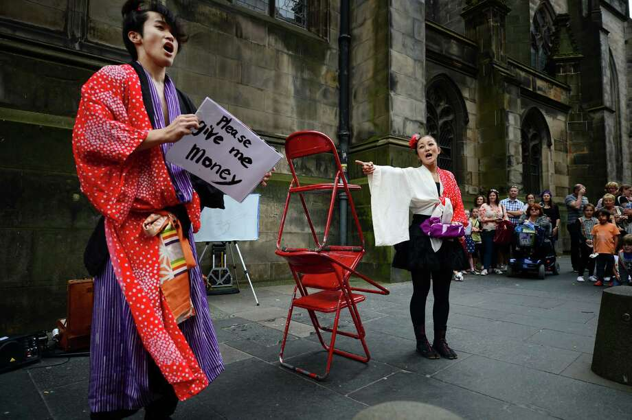 Street entertainers perform on Edinburgh's Royal Mile during the city's Festival Fringe on August 7, 2013 in Edinburgh, Scotland. Photo: Jeff J Mitchell, Getty Images / 2013 Getty Images