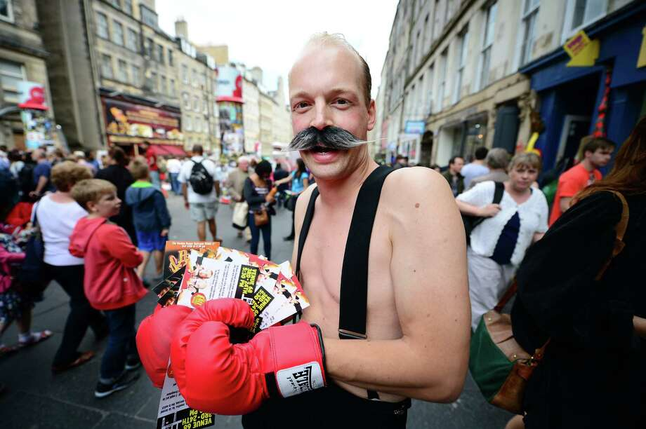 A street entertainer is seen on Edinburgh's Royal Mile during the city's Festival Fringe on August 7, 2013 in Edinburgh, Scotland. Photo: Jeff J Mitchell, Getty Images / 2013 Getty Images