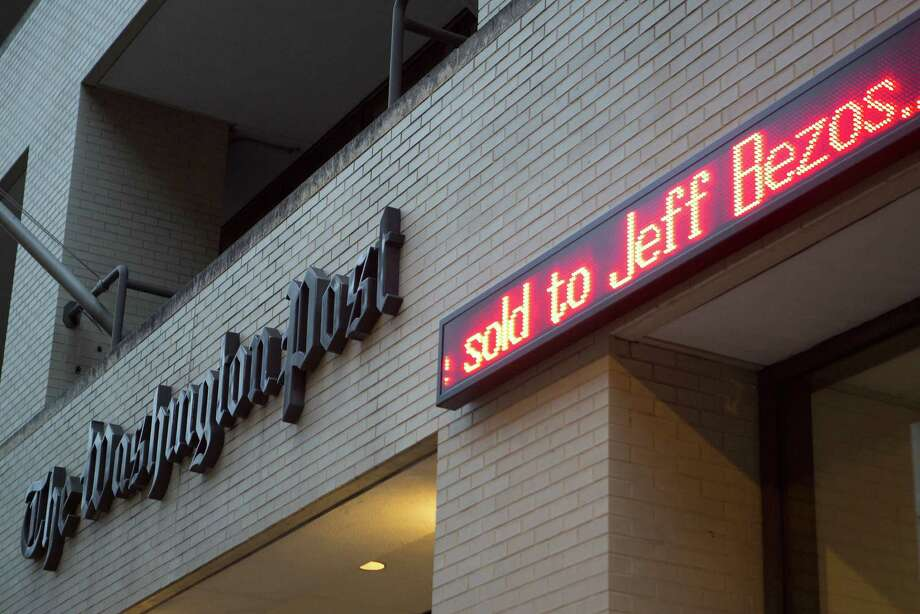 The news that the Washington Post is to be sold to billionaire Jeff Bezos is displayed on an electronic ticker board outside the  Post  headquarters in  D.C. Photo: Bloomberg