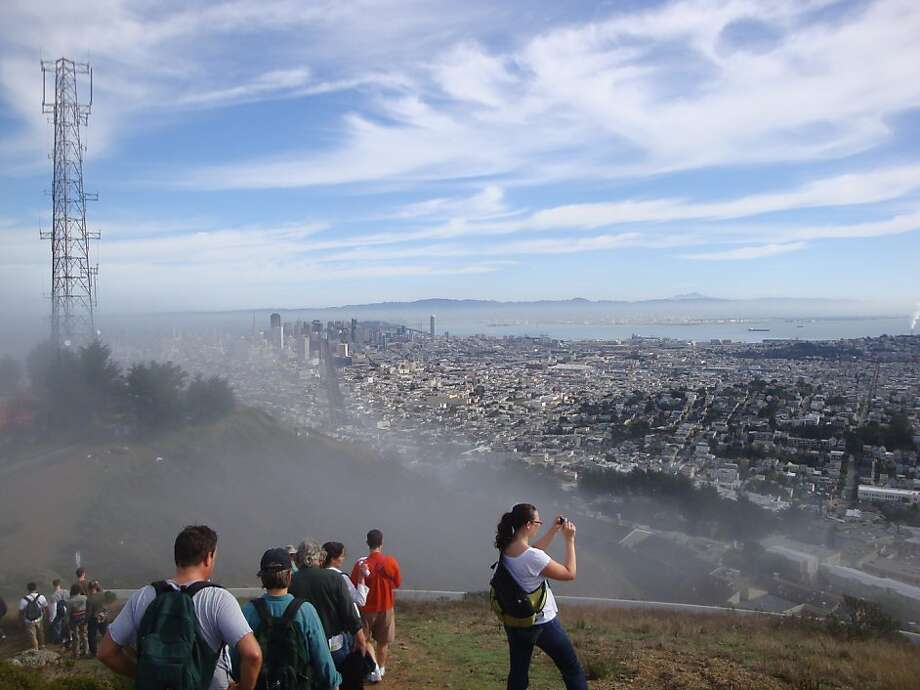Peak2Peak participants take in the view from Twin Peaks during a walk over the city's hills. Photo: Rachael Ludwick