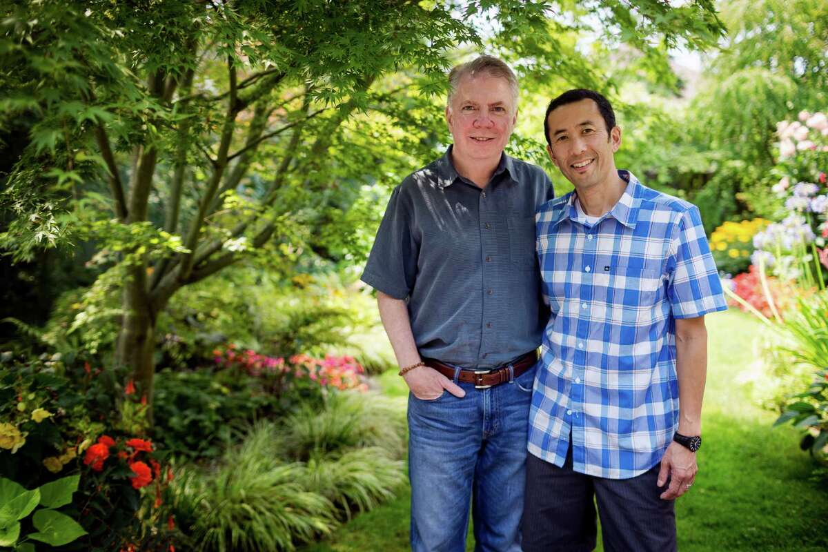 Seattle mayoral candidate Ed Murray, center, photographed with his partner, Michael Shiosaki, right, on Friday, August 9, 2013, at their home in Seattle.