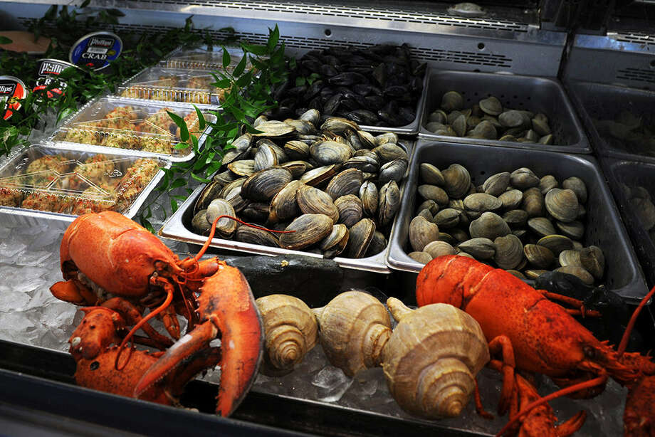 Fresh shellfish is offered for sale at Swanson's Fish Market in Fairfield, Conn. Photo: Ned Gerard / Connecticut Post