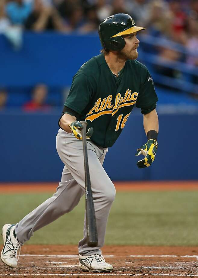 Josh Reddick unleashes one of three home runs he hit in the A's 14-6 win on Friday. Photo: Tom Szczerbowski, Getty Images