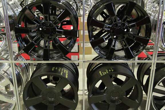 A selection of black wheels at the American Wheel and Tire store in the 11000 block of Northwest Freeway Wednesday, Aug. 7, 2013, in Houston.   ( James Nielsen / Houston Chronicle )