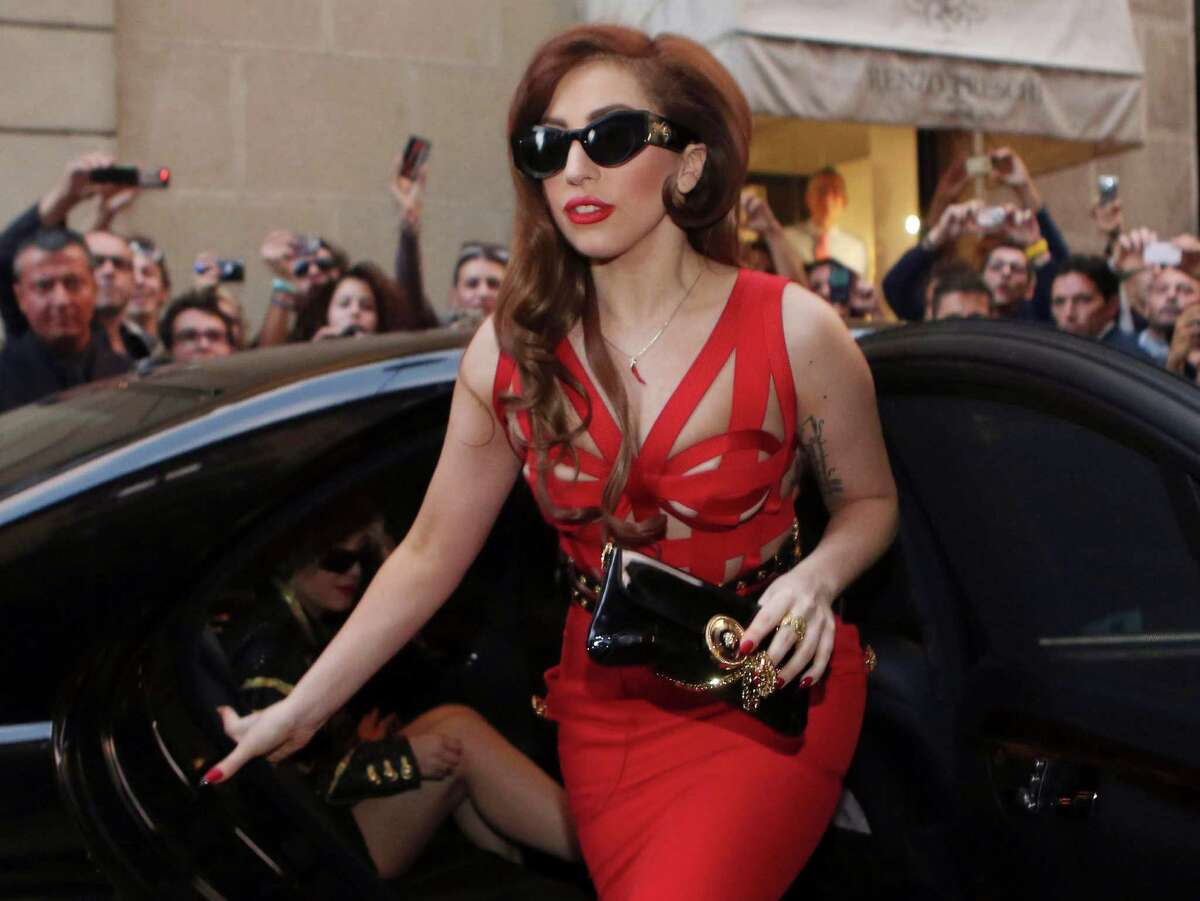 FILE - In this Monday, Oct. 1, 2012 file photo, Lady Gaga arrives at the Versace atelier in Milan, Italy. Lady Gaga is taking her Born This Way Foundation on the road. (AP Photo/Luca Bruno)