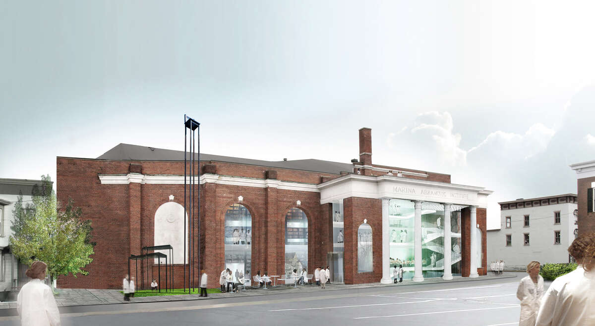 This undated artist's rendering provided by OMA shows a proposed $15 million performance space for duration-based works of art lasting from six hours to several days to be housed in a former tennis center in Hudson, N.Y. Performance artist Marina Abramovic says the 23,000-square-foot facility will feature ramps and specially designed lighting and furniture, including chairs equipped with wheels for visitors who fall asleep during the lengthy performances. (AP Photo/OMA)