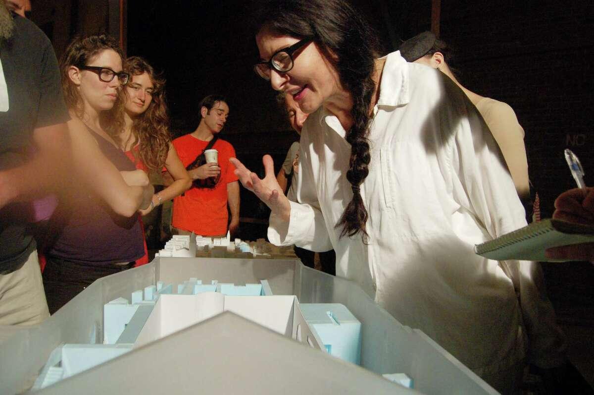 Noted performance artist, Marina Abramovic, right, looks over an architectural model of the Marina Abramovic Institute for the Preservation of Performance Art during a visit to Hudson, N.Y., Sunday Aug. 12, 2012. Abramovic is planning to build a performing arts museum in Hudson, N.Y. The museum is scheduled to open in 2014 and will be housed in a former movie theater. (Scott Waldman / Times Union)