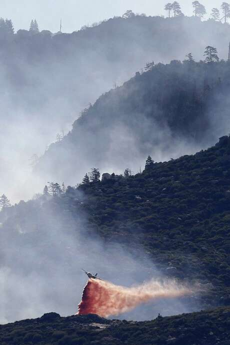 An air tanker drops fire retardant on a blaze near Banning, Calif., that has destroyed 26 homes. California already has seen 4,300 wildfires this year, well above the annual average. Photo: Jae C. Hong / Associated Press