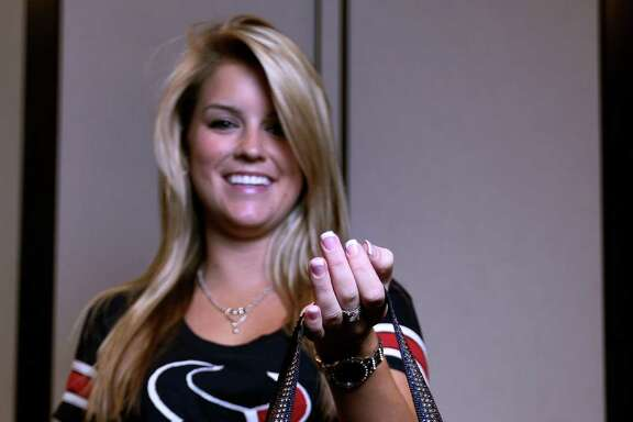 Texans intern Shelby Wells holds one of the new NFL regulation clear plastic bags at Reliant Stadium, Friday, Aug. 9, 2013, in Houston. Houston Texans officials displayed a variety of ways to pack the new NFL clear plastic bags which will be available through club merchandise outlets.  NFL teams will implement an NFL policy this year that limits the size and type of bags that may be brought into stadiums, as teams try to provide a safer environment for the public and expedite fan entry into stadiums. ( Karen Warren / Houston Chronicle )