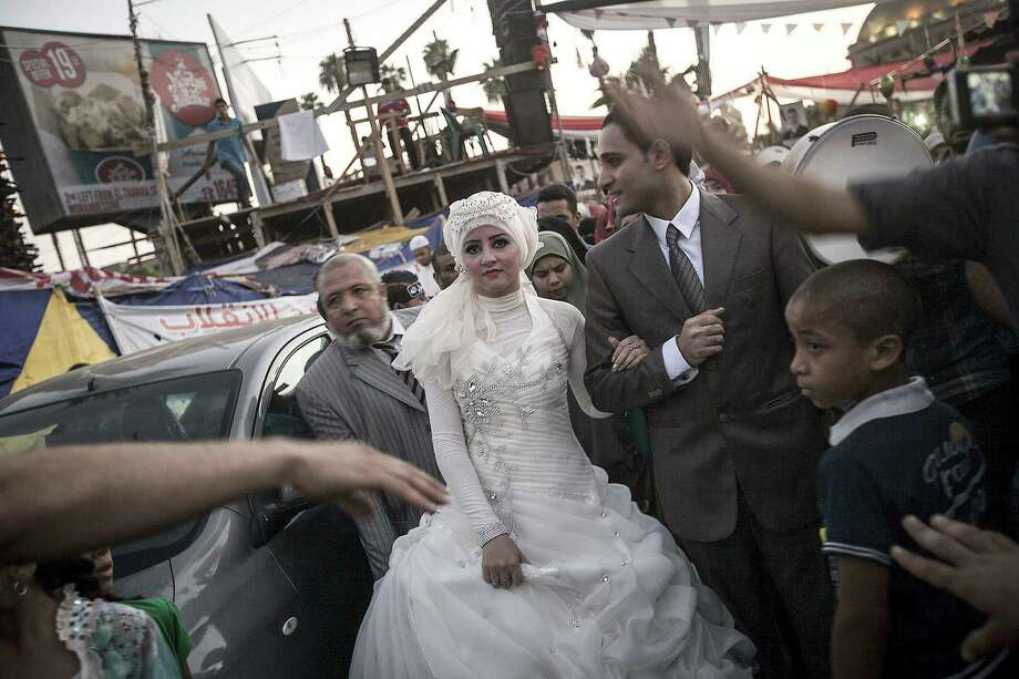 A couple is married during a sit-in near Cairo University in Giza. Observers say ousting the demonstrators from camps would be difficult because of their large numbers. Photo: New York Times