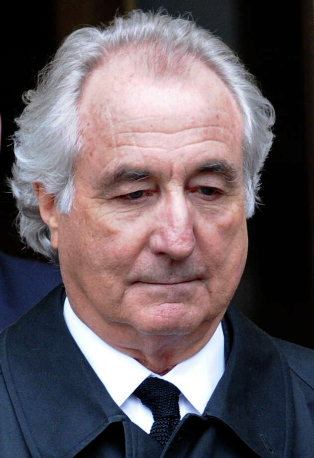 Bernard Madoff set up Bernard L. Madoff Investment Securities in 1960, but it came crashing down in the 2000s after he was accused of running a Ponzi scheme. Madoff was sentenced to more than 150 years in jail by a federal judge for numerous charges.  (AP Photo/Louis Lanzano, File) Photo: Louis Lanzano, FRE / FR77522 AP