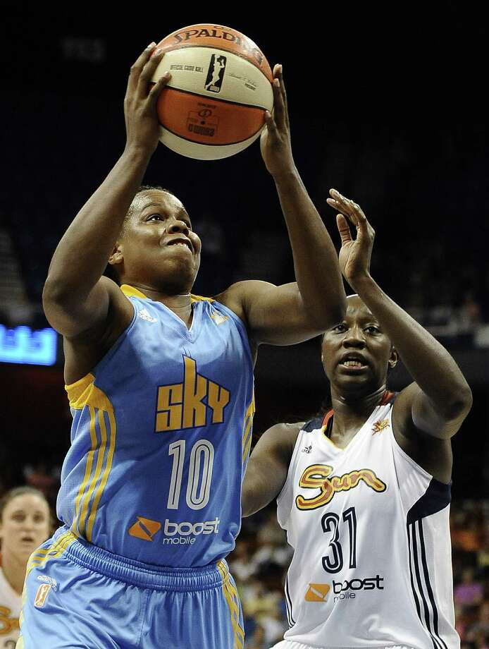 Chicago's Epiphanny Prince (left) goes up for a shot against Connecticut's Tina Charles. Prince had 23 points, four assists and four rebounds in the Sky's road victory. Photo: Jessica Hill / Associated Press
