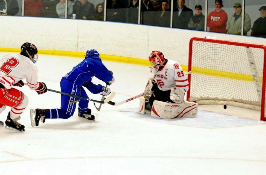 West Haven's Tim Baylis gets the puck past Fairfield Prep goalie Spencer Sodokoff  for the win in overtime Wednesday night at Wonderland of Ice in Bridgeport. Photo: Autumn Driscoll / Connecticut Post