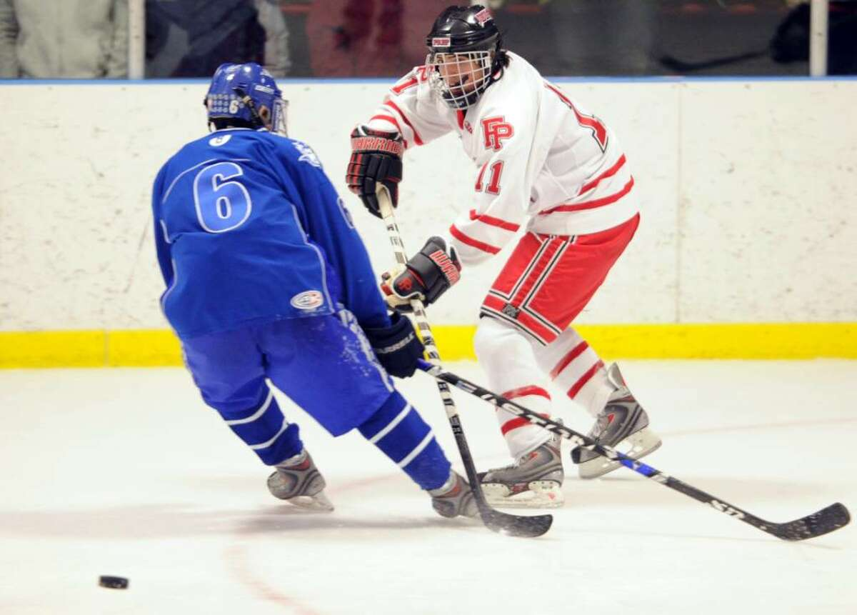 Fairfield Prep's Patrick Hayes passes the puck as West Haven's John Ascenzia defends during Wednesday night's game at Wonderland of Ice in Bridgeport.
