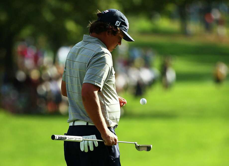 ROCHESTER, NY - AUGUST 09:  Jason Dufner of the United States walks across the 18th green during the second round of the 95th PGA Championship on August 9, 2013 in Rochester, New York.  (Photo by Streeter Lecka/Getty Images) ORG XMIT: 171903782 Photo: Streeter Lecka / 2013 Getty Images