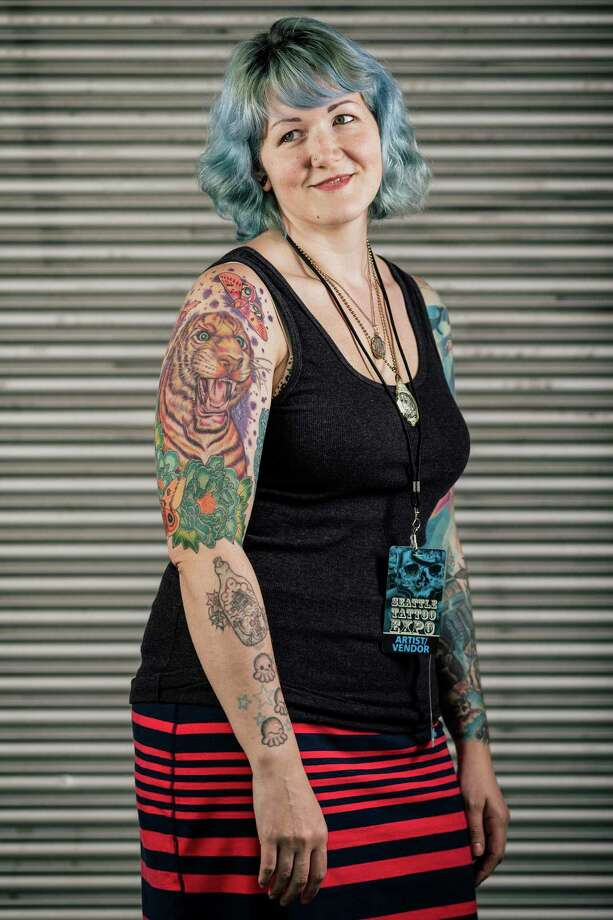 Laura Exley shows off her ink during the first of three days of the Seattle Tattoo Expo Friday, August 9, 2013, at the Seattle Center in Seattle. Photo: JORDAN STEAD, SEATTLEPI.COM / SEATTLEPI.COM