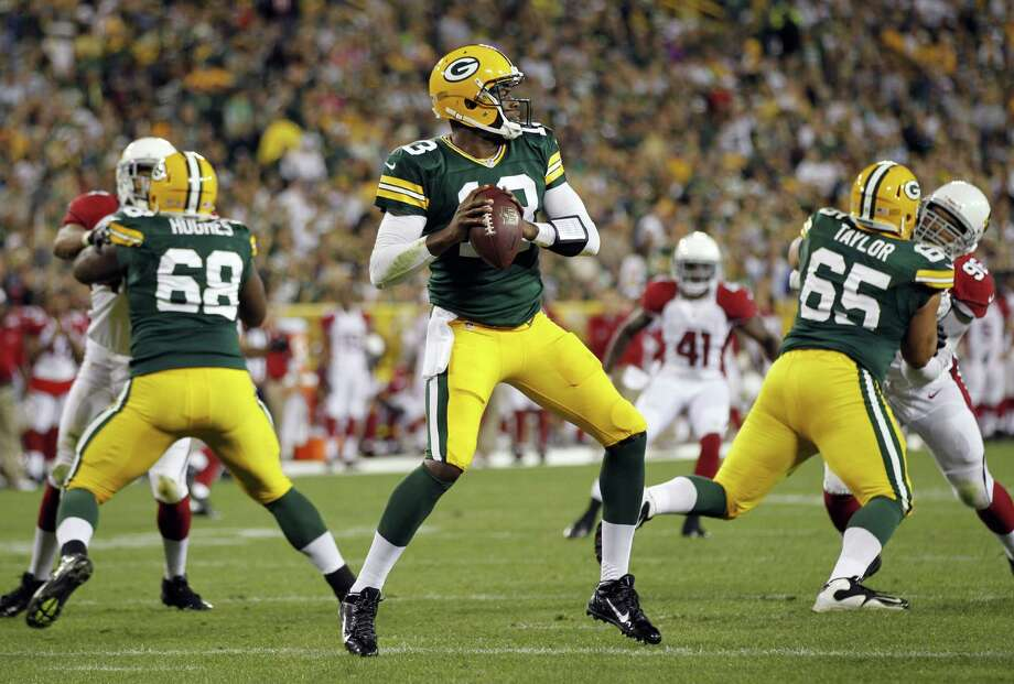 Former Texas quarterback Vince Young, signed by the Packers this week, completed 1 of 3 passes for 7 yards and ran twice for 12 yards in Green Bay's exhibition opener. Photo: Mike Roemer / Associated Press