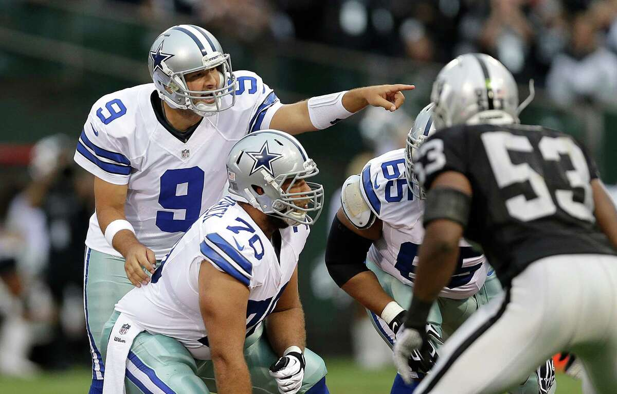 Dallas Cowboys quarterback Tony Romo (9) signals at the line of scrimmage during the first quarter of an NFL preseason football game against the Oakland Raiders in Oakland, Calif., Friday, Aug. 9, 2013. (AP Photo/Marcio Jose Sanchez)