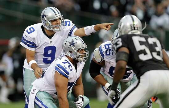 Dallas Cowboys quarterback Tony Romo (9) signals at the line of scrimmage during the first quarter of an NFL preseason football game against the Oakland Raiders in Oakland, Calif., Friday, Aug. 9, 2013. (AP Photo/Marcio Jose Sanchez) Photo: Marcio Jose Sanchez, Associated Press / AP