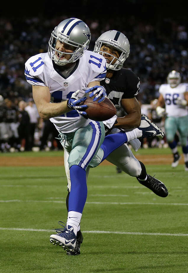 Dallas Cowboys wide receiver Cole Beasley (11) catches a 15-yard touchdown pass from quarterback Kyle Orton in front of Oakland Raiders defensive back Joselio Hanson during the second quarter of an NFL preseason football game in Oakland, Calif., Friday, Aug. 9, 2013. (AP Photo/Marcio Jose Sanchez) Photo: Marcio Jose Sanchez, Associated Press / AP