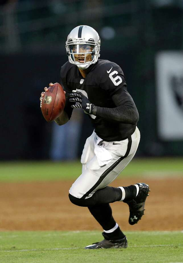 Oakland Raiders quarterback Terrelle Pryor (6) passes against the Dallas Cowboys during the second quarter of an NFL preseason football game in Oakland, Calif., Friday, Aug. 9, 2013. (AP Photo/Marcio Jose Sanchez) Photo: Marcio Jose Sanchez, Associated Press / AP