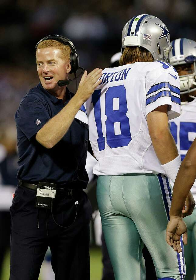 Dallas Cowboys coach Jason Garrett, left, celebrates with quarterback Kyle Orton (18) after Orton's 15-yard touchdown pass to Cole Beasley during the second quarter of an NFL preseason football game against the Oakland Raiders in Oakland, Calif., Friday, Aug. 9, 2013. (AP Photo/Marcio Jose Sanchez) Photo: Marcio Jose Sanchez, Associated Press / AP