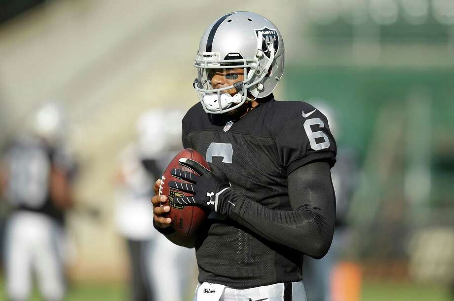Oakland Raiders quarterback Terrelle Pryor (6) warms up before an NFL preseason football game in Oakland, Calif., Friday, Aug. 9, 2013. (AP Photo/Ben Margot) Photo: Ben Margot, Associated Press / AP