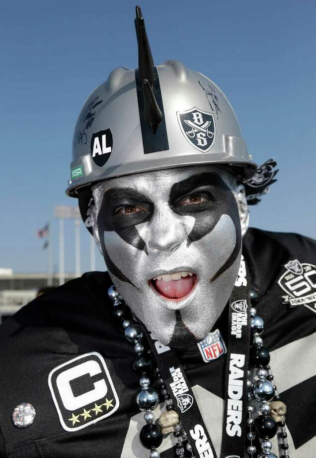 "Oakland Raiders fan ""Raider Reo"" Aaron Crist poses for photographs before an NFL preseason football game between the Oakland Raiders and the Dallas Cowboys in Oakland, Calif., Friday, Aug. 9, 2013. (AP Photo/Marcio Jose Sanchez) Photo: Marcio Jose Sanchez, Associated Press / AP"