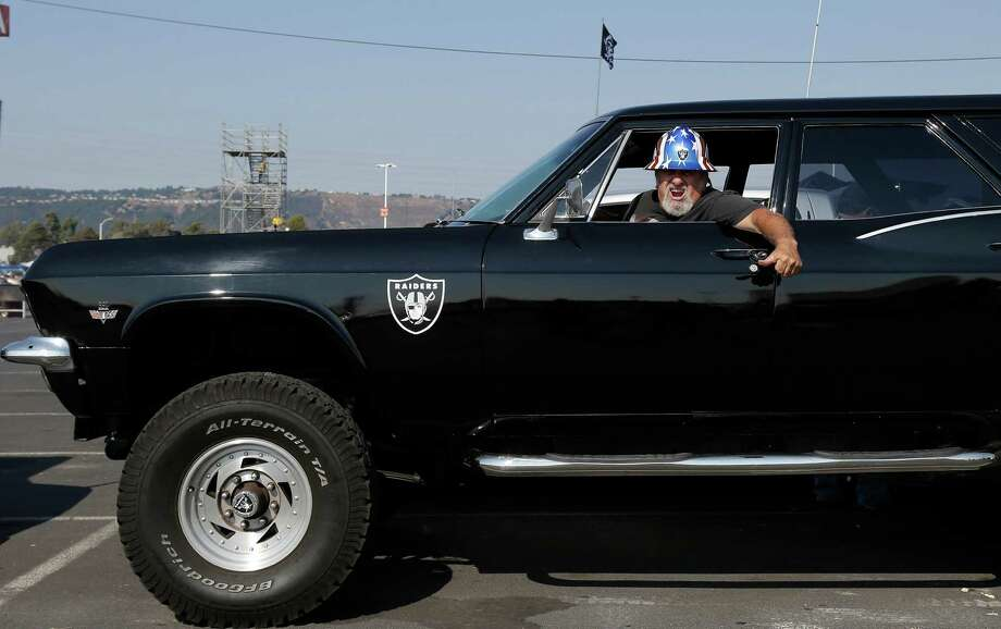 Oakland Raiders fan Andrew DiDomenico sits in his car in the O.co Coliseum parking lot before an NFL preseason football game between the Oakland Raiders and the Dallas Cowboys in Oakland, Calif., Friday, Aug. 9, 2013. (AP Photo/Marcio Jose Sanchez) Photo: Marcio Jose Sanchez, Associated Press / AP