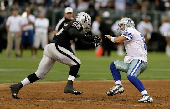 Oakland Raiders outside linebacker Sio Moore (55) prepares to sack Dallas Cowboys quarterback Tony Romo (9) during the first quarter of an NFL preseason football game in Oakland, Calif., Friday, Aug. 9, 2013. (AP Photo/Ben Margot) Photo: Ben Margot, Associated Press / AP