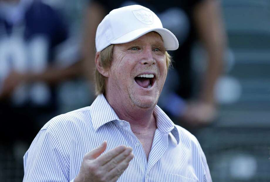 Oakland Raiders owner Mark Davis watches as players warm up before an NFL preseason football game against the Dallas Cowboys in Oakland, Calif., Friday, Aug. 9, 2013. (AP Photo/Ben Margot) Photo: Ben Margot, Associated Press / AP