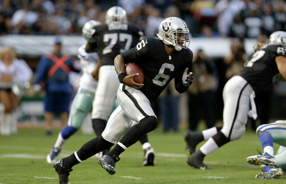 Oakland Raiders quarterback Terrelle Pryor (6) runs against the Dallas Cowboys during the first half of an NFL preseason football game in Oakland, Calif., Friday, Aug. 9, 2013. (AP Photo/Marcio Jose Sanchez) Photo: Marcio Jose Sanchez, Associated Press / AP