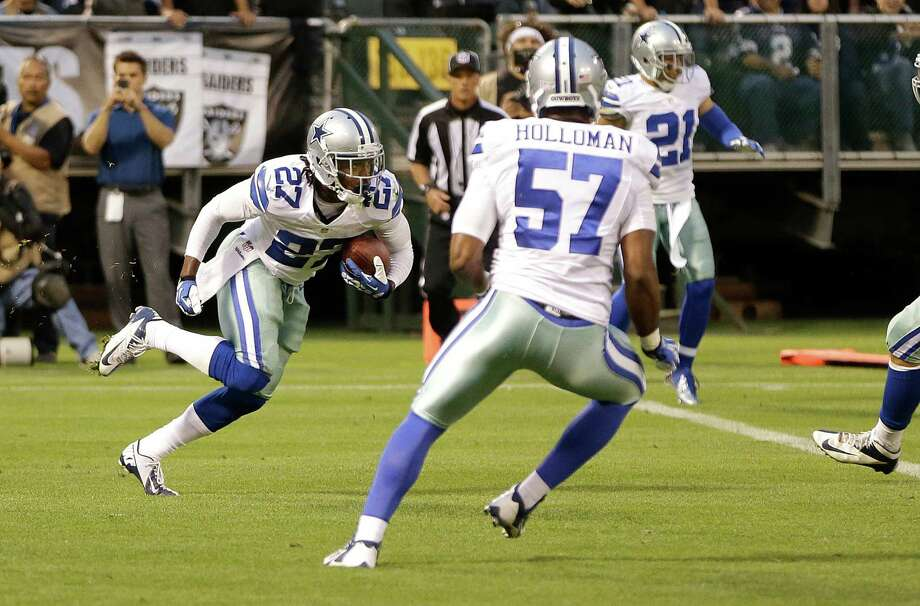 Dallas Cowboys defensive back J.J. Wilcox (27) returns an interception from Oakland Raiders quarterback Terrelle Pryor during the second quarter of an NFL preseason football game in Oakland, Calif., Friday, Aug. 9, 2013. (AP Photo/Ben Margot) Photo: Ben Margot, Associated Press / AP