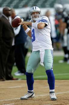 Dallas Cowboys quarterback Tony Romo (9) warms up before an NFL preseason football game against the Oakland Raiders in Oakland, Calif., Friday, Aug. 9, 2013. (AP Photo/Marcio Jose Sanchez) Photo: Marcio Jose Sanchez, Associated Press / AP