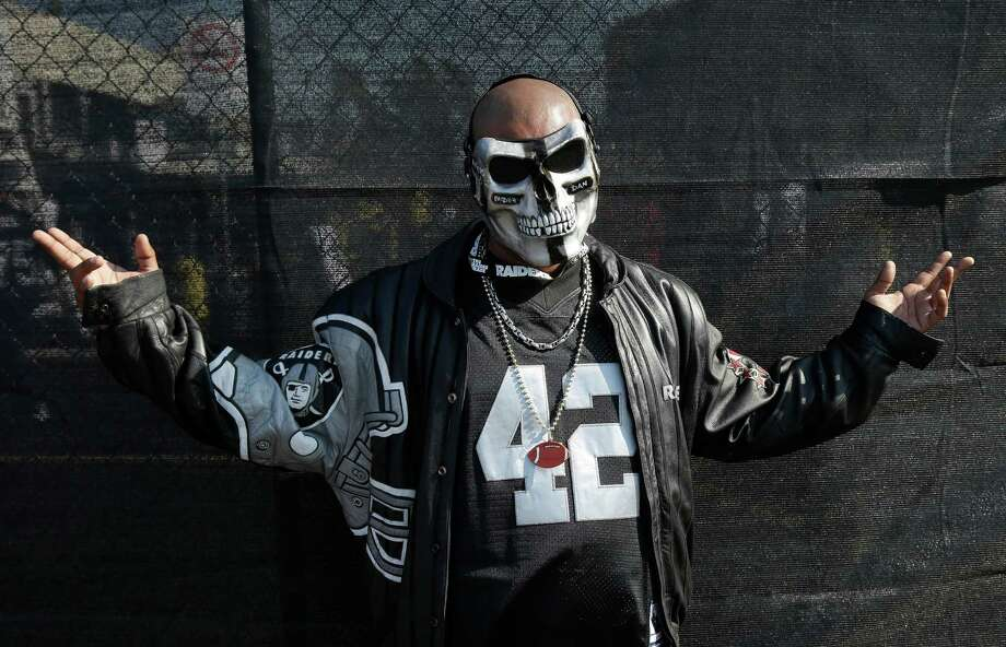 Oakland Raiders fan Raider Dan poses for photographs before an NFL preseason football game between the Oakland Raiders and the Dallas Cowboys in Oakland, Calif., Friday, Aug. 9, 2013. (AP Photo/Marcio Jose Sanchez) Photo: Marcio Jose Sanchez, Associated Press / AP