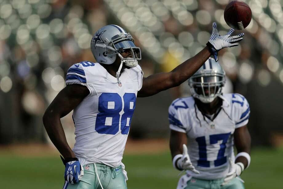 Dallas Cowboys wide receiver Dez Bryant (88) and wide receiver Dwayne Harris (17) warm up before an NFL preseason football game against the Oakland Raiders in Oakland, Calif., Friday, Aug. 9, 2013. (AP Photo/Marcio Jose Sanchez) Photo: Marcio Jose Sanchez, Associated Press / AP