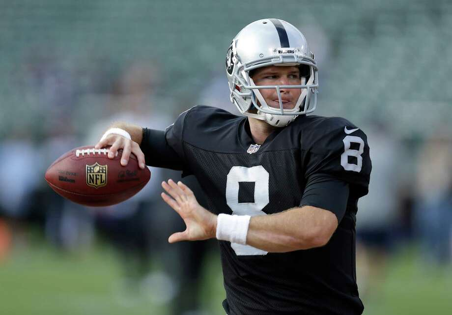 Oakland Raiders quarterback Tyler Wilson (8) warms up before an NFL preseason football game against the Dallas Cowboys in Oakland, Calif., Friday, Aug. 9, 2013. (AP Photo/Ben Margot) Photo: Ben Margot, Associated Press / AP